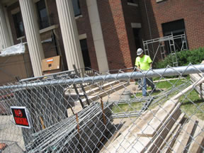 Fencing and construction supplies outside Miner Library