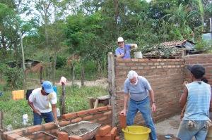 Volunteers buidling house